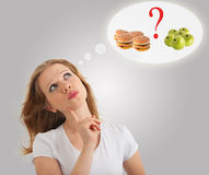 食物健康不健康的妇女年轻人 库存照片
