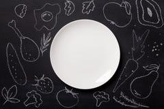 食物画与在黑板的白垩 免版税库存图片