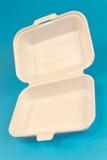 食物的聚苯乙烯泡沫塑料箱子在蓝色 免版税图库摄影