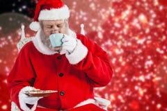 食用的圣诞老人的综合图象咖啡用曲奇饼 免版税库存照片