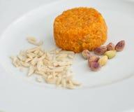素食主义者点心橙色皮肤用杏仁和坚果 免版税库存图片
