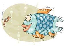 饥饿的鱼和蠕虫在勾子 免版税库存照片