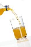 饮料玻璃橙色倾吐 图库摄影