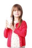 饮用的女孩少许牛奶 库存图片