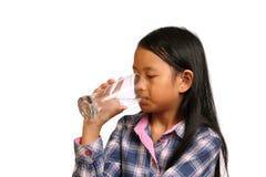 饮用的女孩少许水 库存照片