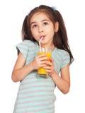 饮用的女孩汁液 图库摄影