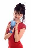饮用的女孩汁液 免版税库存照片