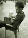 饮用的少年 免版税库存图片