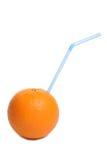 饮用的橙色秸杆 库存图片