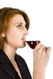 饮用的红葡萄酒 库存照片