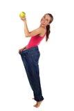 饮食作用。 有太大长裤的妇女 免版税库存照片