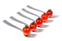 饮食健康营养的概念 在叉子的西红柿 免版税库存照片