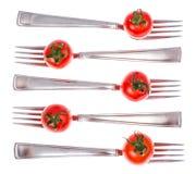 饮食健康营养的概念 在叉子的西红柿 免版税库存图片
