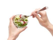 饮食叉子递沙拉小的妇女 免版税库存图片