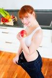 饮食太大的裤子妇女 库存图片