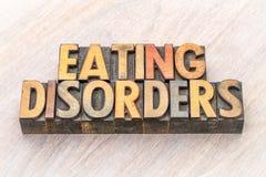 饮食失调在木类型的词摘要 免版税库存照片