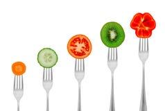 饮食概念、菜和果子在叉子 库存图片
