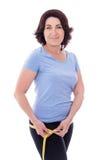 饮食概念-有措施的t美丽的亭亭玉立的运动的成熟妇女 免版税库存照片