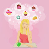 饮食的女孩作梦蛋糕和甜点的 库存照片