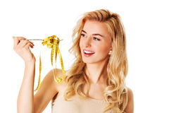 饮食的妇女与在叉子的措施磁带 库存图片