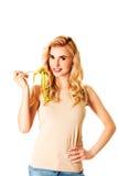 饮食的妇女与在叉子的措施磁带 免版税库存照片
