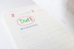 饮食的起点在约会记事本的 库存图片