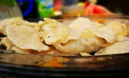 饺子 在葡萄酒生动的颜色的艺术性的神色 免版税图库摄影