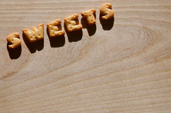 饼干 可食的信件 免版税库存照片