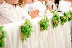 首先接受圣洁儿童的圣餐 免版税图库摄影