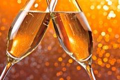 香槟槽细节在橙色光bokeh背景的 库存照片