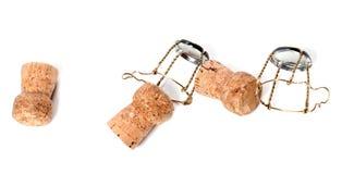 从香槟酒和muselets的黄柏 免版税库存图片