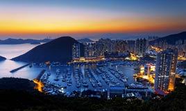香港美好的日落,阿伯丁台风风雨棚 免版税库存图片