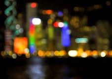 香港都市风景在暮色时间,被弄脏的照片boke的海视图 库存照片