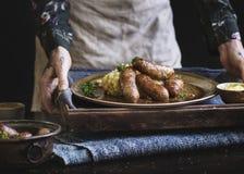 香肠和饲料食物摄影食谱想法 库存照片
