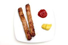 香肠用番茄酱和芥末如从上面被看见 图库摄影