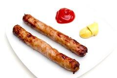 香肠用番茄酱和芥末 免版税图库摄影
