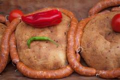 香肠面包和辣椒粉 免版税库存照片