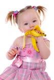 香蕉少许吃女孩 免版税库存图片