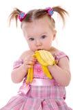 香蕉少许吃女孩 库存照片