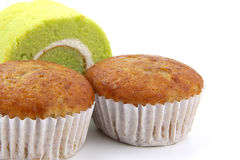 香蕉杯形蛋糕和Pandan和椰子调味的卷结块 库存照片