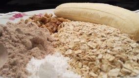 香蕉燕麦和乳清蛋白烹调的 库存图片