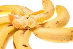 香蕉用桔子 免版税图库摄影