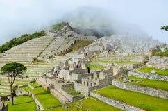 马丘比丘,库斯科地区,秘鲁2013年6月4日:15世纪印加人城堡马丘比丘的住宅区的细节 免版税库存照片