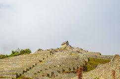 马丘比丘,库斯科地区,秘鲁2013年6月4日:15世纪印加人城堡马丘比丘的住宅区的细节 库存图片