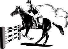 马和车手在跳跃期间 免版税库存图片