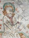 马太壁画有风镜的,组成他的福音书书 免版税库存图片