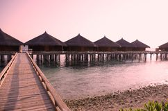马尔代夫在黄昏的海滩胜地 免版税图库摄影