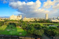 马尼拉市地平线在菲律宾 从王城区看见的埃尔米塔和Paco区 免版税库存图片