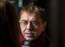 马德里首放星期戏院事件的胡安・卡洛斯Monedero在卡亚俄广场,马德里 图库摄影