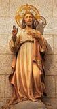 马德里-耶稣雕象的心脏从百升教会的。 Theresia 图库摄影
